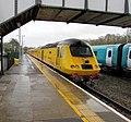 Yellow Network Rail train passes through Haverfordwest railway station (geograph 6065903).jpg