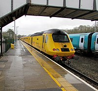 Yellow Network Rail train passes through Haverfordwest railway station (geograph 6065903).jpg