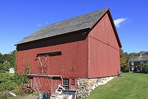 Barn - Timber framed with siding of vertical boards was typical in early New England. Red is a traditional color for paint. Connecticut.