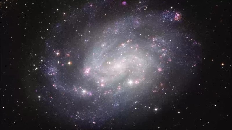File:Zooming into the southern spiral NGC 300 (ESO 1037b).webm
