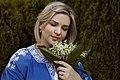 День Вишиванки. Молода україночка у вишитій синій сукні серед квітів 22.jpg