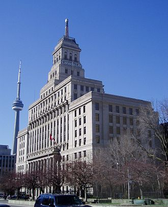 Canada Life Building - The historic Canada Life Building, with a prominent weather beacon at its pinnacle, and the considerably taller CN Tower in the background to its left