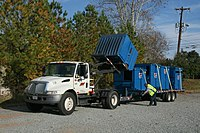 An International DuraStar used to transport Dumpsters.