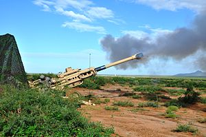 Brigade Modernization Command - 2/1 AD soldiers firing the M777 Howitzer at White Sands Missile Range. (Photo By Wes Elliott, U.S. Army)