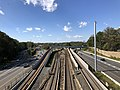 2018-10-23 13 23 36 View west toward the junction of Interstate 66 and Virginia State Route 267, and the Orange and Silver lines of the Washington Metro, from the overpass for Haycock Road (Virginia State Route 703) in Fairfax County, Virginia.jpg