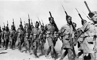 Military history of New Zealand during World War II - Soldiers of the 2nd NZEF, 20th Battalion, C Company marching in Baggush, Egypt, September 1941.