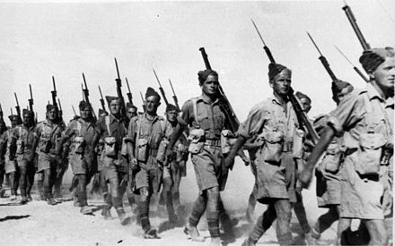 Soldiers of the 2nd NZEF, 20th Battalion, C Company marching in Baggush, Egypt, September 1941. 20th Battalion infantry marching in Baggush, Egypt, September 1941.jpg