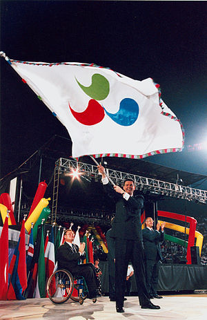 Michael Knight (Australian politician) - Michael Knight with the IPC flag at the closing ceremony of the 1996 Summer Paralympics