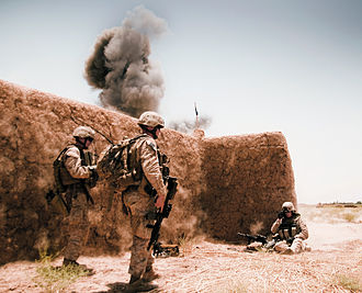 Bomb disposal - Marines conducting a controlled detonation of improvised explosive devices in Afghanistan.
