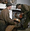 428 Battery crew handling 8-inch gun propellant charges WWII IWM TR 571.jpg