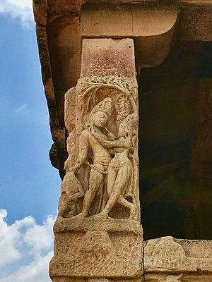 Aihole - An amorous couple at the Durga temple.