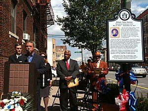 Lucio Fernandez - Fernandez (at podium) at the dedication ceremony of a historical marker for William Ranney at the location in Union City where Ranney's home once stood, one of many such markers that Fernandez has been instrumental in creating. Over Fernandez's right shoulder is his frequent collaborator, City Historian Gerard Karabin.