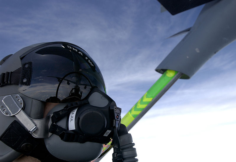 File:94th Fighter Squadron being refueled by a jet from the 128th Air Refueling Wing with a helmet reflection.jpg