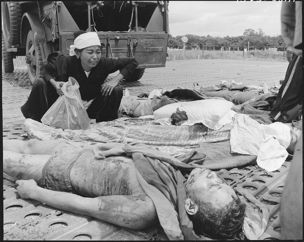 A Vietnamese woman weeps over the body of her husband, one of the Vietnames Army casualties suffered in the war with... - NARA - 542295
