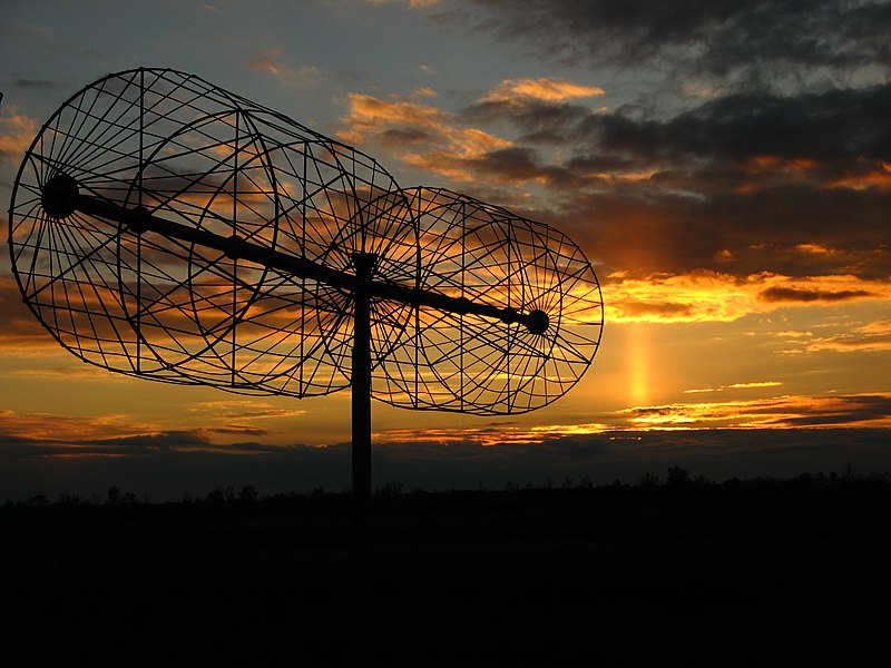 A dipole of UTR-2 radio telescope antenna array and sunset with light pillar.jpg