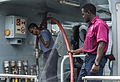 A member of the Saint Lucian Fire Services, right, stands by as a crew member aboard the Trinidad and Tobago Defense Force fast patrol craft TTS Chaconia replenishes the vessel's fresh water supply May 21 130521-N-KL795-061.jpg