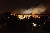 A nighttime view of the Pentagon Building showing smoke rising from the building after the September 11, 2001 attacks 010911-N-PU293-077.jpg