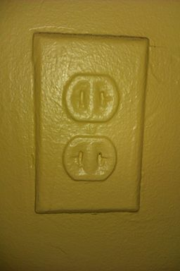 A power outlet painted over