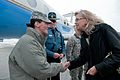 A soldier greets Acting Deputy Defense Secretary Christine H. Fox upon her arrival at Manhattan Regional Airport, Manhattan, Kan., near Fort Riley 140210-A-xxxxS-001.jpg