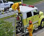 A yellow and white fire engine at Guantanamo -a.jpg