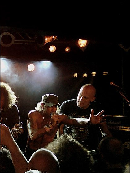 Mark Tornillo (pictured in the middle) with guitarist Wolf Hoffmann in Stockholm, May 20, 2010. Tornillo replaced Udo Dirkschneider as the band's vocalist, when Accept reformed in 2009. AcceptStockolm2010-2.JPG