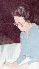 Ade Irawan signing autographs, Festival Film Indonesia (1982), 1983, p55 (cropped).jpg