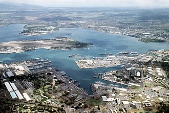 Pearl Harbor is the home of the largest U.S. Navy fleet in the Pacific. The harbor was attacked on December 7, 1941, by the Japanese Empire, bringing the United States into World War II. Aerial view of Pearl Harbor on 1 June 1986 (6422248).jpg