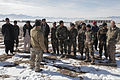 Afghan National Army Special Forces members with the 8th Special Operations Kandak and members of a civil mine reduction group gather around an instructor to hear details of the final practical test for an 140111-A-CI200-022.jpg