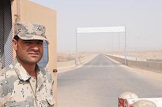 Afghan Border Police - Afghan border agent near the Afghanistan-Tajikistan Bridge at Sher Khan Bandar in Kunduz Province