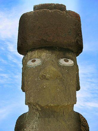 Puna Pau - A red scoria pukao on the head of a moai at Ahu Tahai, made using rock from Puna Pau