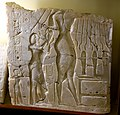 Alabaster sunken relief depicting Akhenaten, Nefertiti, and daughter Meritaten. Early Aten cartouches on king's arm and chest. From Amarna, Egypt. 18th Dynasty. The Petrie Museum of Egyptian Archaeology, London.jpg