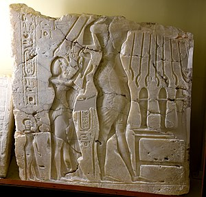 Meritaten - Alabaster sunken relief depicting Akhenaten, Nefertiti, and daughter Meritaten. Early Aten cartouches on king's arm and chest. From Amarna, Egypt. 18th Dynasty. The Petrie Museum of Egyptian Archaeology, London