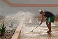 An Iraqi employee cleans the pool deck at the Jadida public swimming pool located Eastern Baghdad, Iraq, June 7, 2008 080607-A-YE931-010.jpg