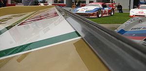Gurney flap - A Gurney flap on the trailing edge of the rear wing of a Porsche 962.