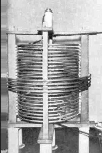 Inductor - An antenna tuning coil at an AM radio station. It illustrates high power high Q construction: single layer winding with turns spaced apart to reduce proximity effect losses, made of silver-plated tubing to reduce skin effect losses, supported by narrow insulating strips to reduce dielectric losses.