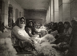 Armenians in Georgia - Armenian refugees from Turkey carding wool in Tiflis. Photograph by Melville Chater from the National Geographic Magazine, 1920.