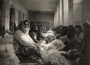 Armenian Genocide survivors - Image: Armenian refugees carding wool in Tiflis (Nat Geo 36, 1920)