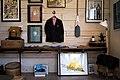 Art hanging in wood building (Unsplash).jpg