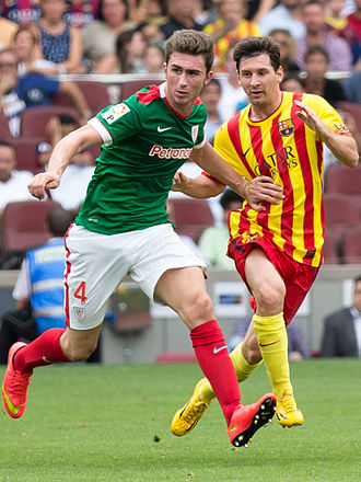 Away colours - Athletic Bilbao (left) and FC Barcelona playing by choice in change kits in their respective Basque and Catalan regional flag colours (2014) – their usual kits do not clash