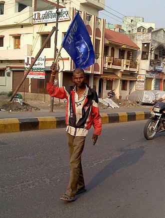 Bahujan Samaj Party - Bahujan Samaj Party claims to represent the low and lowly. A man carrying the BSP flag.