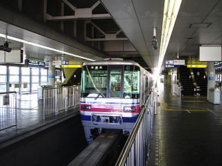 Bampaku-kinen-kōen Station (Osaka) railway station in Suita, Osaka prefecture, Japan