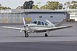 Beech V35 Bonanza (VH-DEV) taxiing at Wagga Wagga Airport.jpg