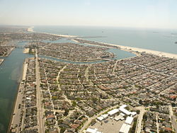 Belmont Park is in the foreground in this photo, with Naples Island is in the middle distance, and The Peninsula and the neighboring city of Seal Beach beyond, looking southeast.