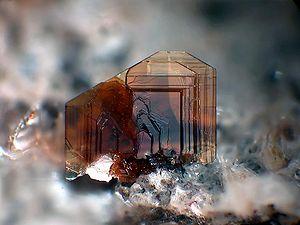 Biotite - Thin tabular biotite aggregate (Image width: 2.5 mm)