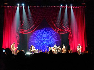 Never Ending Tour - (From left to right) Stu Kimball, Bob Dylan, Donnie Herron, George Recile, Tony Garnier and Denny Freeman performing in Bologna, Italy, November 10, 2005