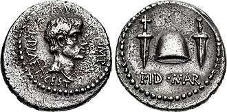 Assassination of Julius Caesar - Denarius of Brutus and Lucius Plaetorius Cestianus, minted in 43–42 BC.  Brutus is depicted on the obverse.  The reverse shows a pileus between two daggers, with the legend EID MAR, commemorating the assassination.