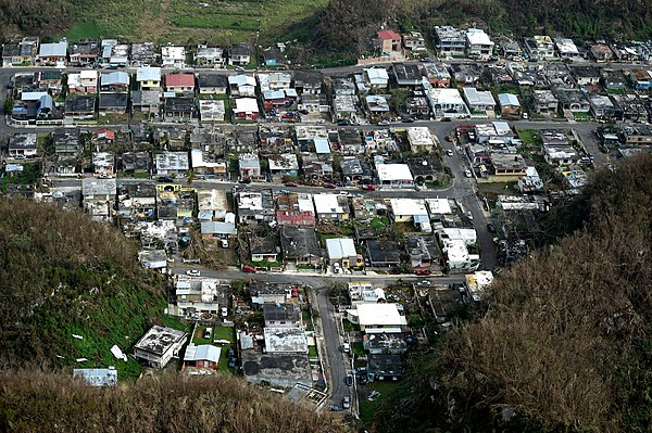 A neighborhood in Puerto Rico heavily damaged by the storm Buildings damaged (23538370818).jpg