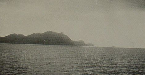 This picture shows seashore of hills as seen off Chi-Fu Harbor, China west of Seoul, Korea.