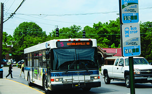 Lextran - A Lextran bus picks up students in front of the Main Building on South Limestone on Wednesday, June 17, 2015 in Lexington, Kentucky.  Photo by Taylor Pence