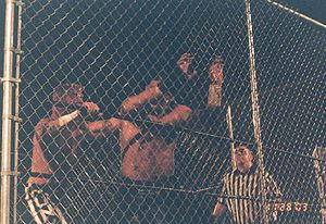 CM Punk - Punk during a cage match against Raven at Ring of Honor's The Conclusion on November 28, 2003, in Fairfield, Connecticut